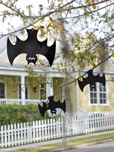 Looking for a fun and inexpensive way to add a little spooky to your yard or porch this Halloween? All you need is some black craft foam, googly eyes and fishing line to create a flock of wild, weatherproof bats.